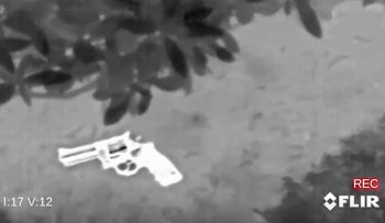 Thermal image of a gun on the ground