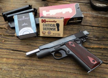 Colt 1911 pistol with three boxes of ammunition