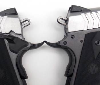 two custom grade beaver tail grip safeties on SR1911 pistols