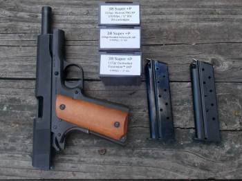 .38 Super handgun with two MecGar magazines and three ammunition boxes