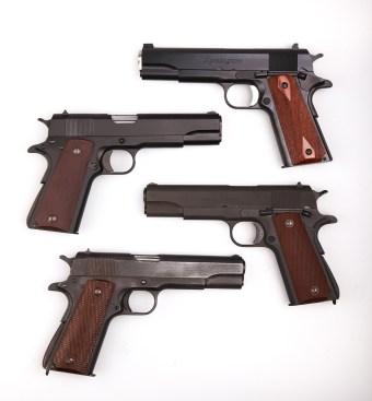four 1911 .45 ACP handguns