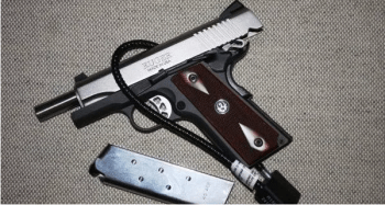 Ruger semi-automatic pistol with cable gun lock protesting preemption