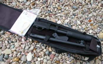 Mossberg JIC II disassembled in back soft case