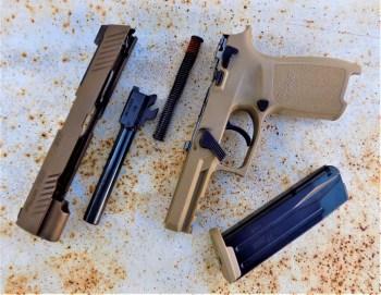 field stripped SIG P320 M17 handgun