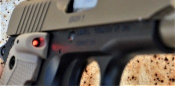 Beam of a laser on a pistol
