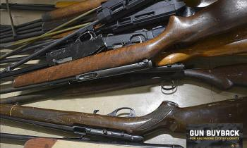 Old .22 rifles and shotgun from a gun buyback