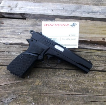 Browning Hi-Power clone right black with Winchester ammunition