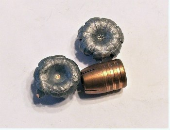 one intact bullet with two upset bullets