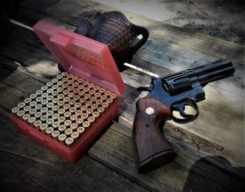 Colt Python revolver with box of handloaded ammunition
