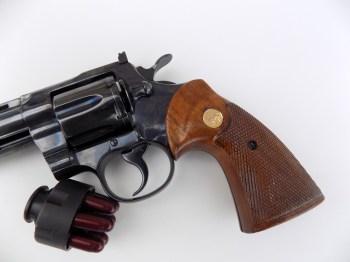 Colt Python revolver with speed loader