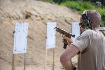 Speed loading a pistol on the shooting range for Box Drills