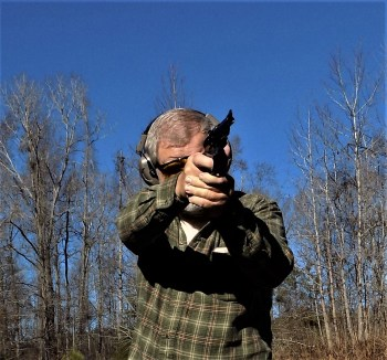 Firing a pistol with a two-hand grip
