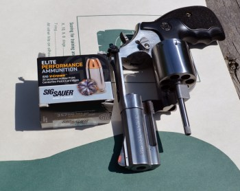 SIG Sauer ammunition box with an unloaded revolver