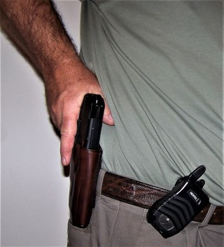 Presenting a handgun from a leather holster