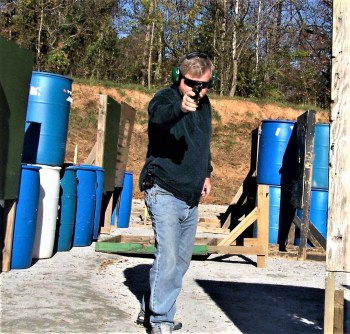 Holding a pistol with a one-hand combat stance