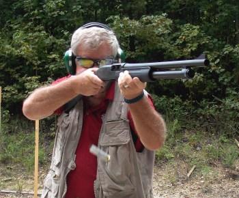 Bob Campbell shooting a pump shotgun