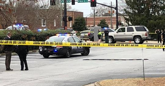 Alpharetta police car with yellow crime scene tape were armed good guys stopped a shooting