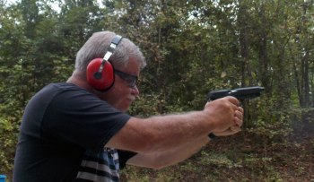 Bob Campbell shooting a double tap with a .38 Super pistol
