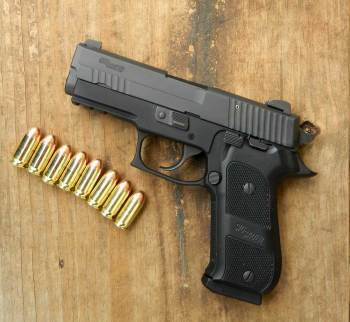 SIG Sauer pistol with eight rounds of ammunition for home defense