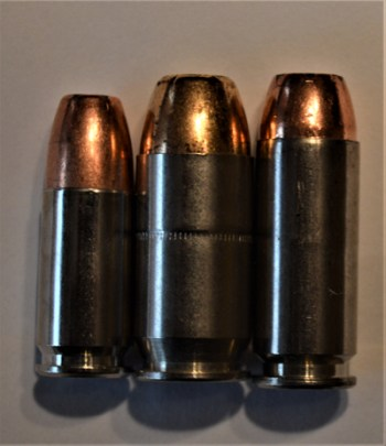 Left to right - 9mm, .45, and 10mm cartridges.