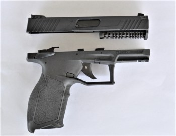Taurus TX22 pistol with the slide removed from the frame