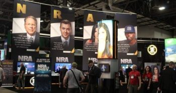 NRA Convention center banners of NRA TV hosts speaking against gun control lobby