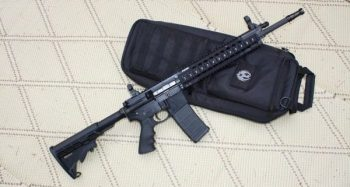 AR-15 rifle on a black case for gun control debate