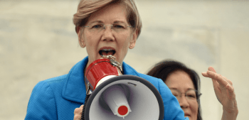 Senator Elizabeth Warren talking through a megaphone speaking about gun control