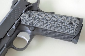 Black and gray Shredder grips on a Guncrafter Commander pistol