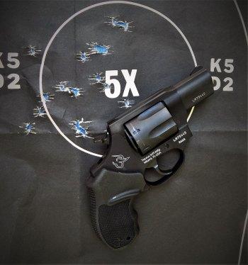 Taurus revolver on a black silhouette target