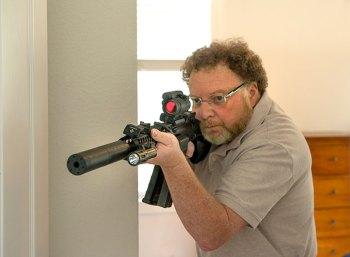 David Kenik aiming an AR-15 for home defense.