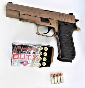 SIG Sauer Emperor Scorpion pistol left profile with Hornady Critical Duty ammunition box
