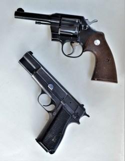 .38 Special Colt Revolver above a black 9mm 1911 pistol