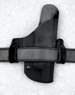 Straight cant leather holster on a gun belt