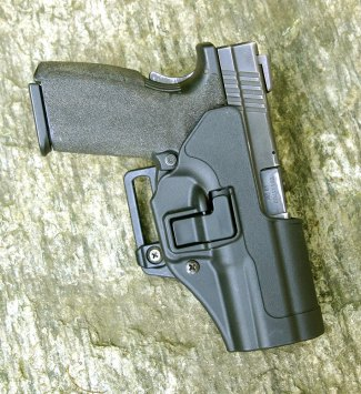 Safariland Automatic Locking System (ALS) holster with polymer pistol inserted