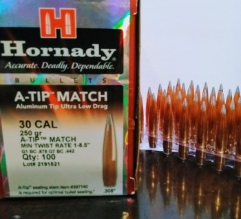 Box of Hornady A Tip bullets with several handloaded cartridges