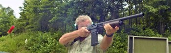 Bob Campbell shooting a magazine fed pump action shotgun