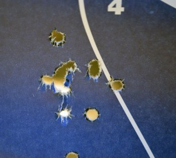 open group of bullet holes from a .380 caliber Beretta handgun