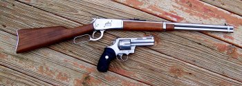 Levr action rifle and revolver both chambered for .45 Colt