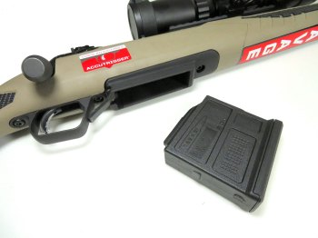 Polymer magazine next to the loading port of the Savage 110 Scout rifle