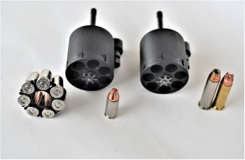 Taurus 692 with two empty cylinders for calibers ranging from 9mm to .357 Magnum