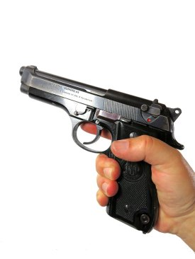 hand holding the Beretta 92S pistol
