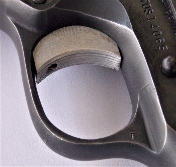 adjustable trigger on a Colt 1911 pistol