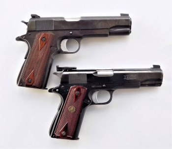 Old Colt 1911 handgun for carry, top. Madore Bullseye gun for target shooting, bottom