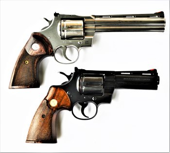 New Colt Python revolver, top, original Colt Python revolver below