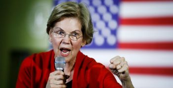 Elizabeth Warren with Clenched fist and mic rallying for new ammo tax
