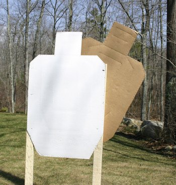 Cardboard target partially obscured to represent a hostage