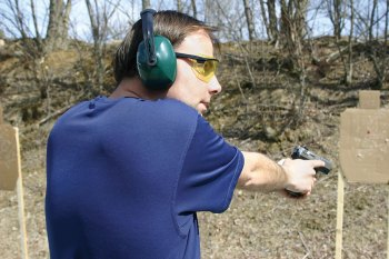 Man at a pistol range looking to the sides to check for additional threats for street training