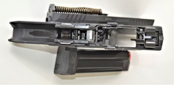 Top view of the lower receiver and internal part on the Arex Rex Delta
