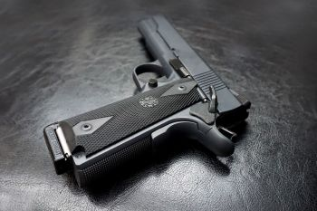 1911 handgun with Wilson Combat magazine